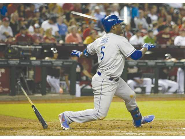 Los Angeles Dodgers Juan Uribe (5) follows through on an RBI single in the against the Arizona Diamondbacks on Monday in Phoenix.
