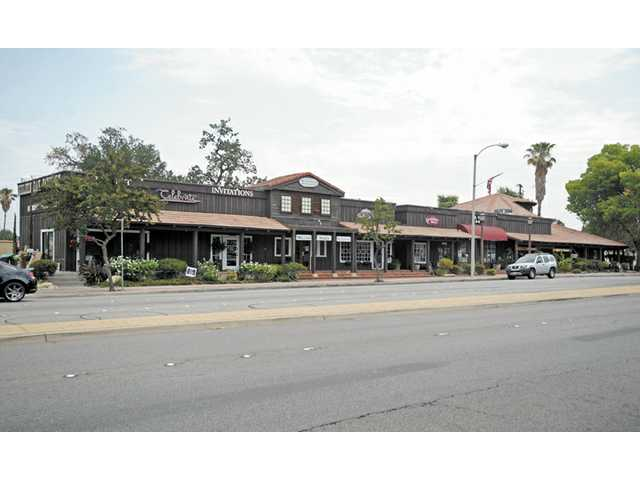 The Western-style commercial building at 23101 Lyons Ave. in Newhall has been sold.