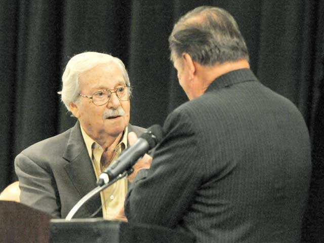 Korean War veteran Chuck Morris, left, is recognized by Santa Clarita Mayor Bob Kellar at the Patriot Luncheon at the Hyatt Regency Valencia on Thursday. Signal photo by Jonathan Pobre.