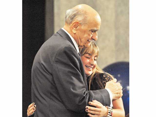 Fred Lionetti, left, hugs his granddaughter Josie after he is recognized at the Patriot Luncheon at the Hyatt Regency Valencia on Thursday. Signal photo by Jonathan Pobre.