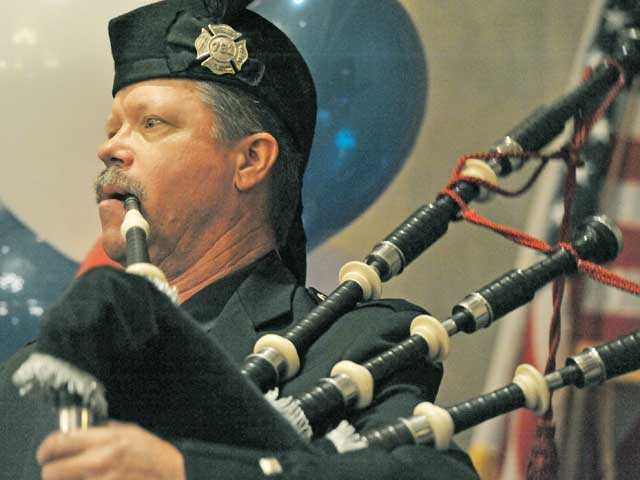 Firefighter Simon Sage of Fire Station 126 performs on the bagpipe at the Patriot Luncheon at the Hyatt Regency Valencia on Thursday. Signal photo by Jonathan Pobre.