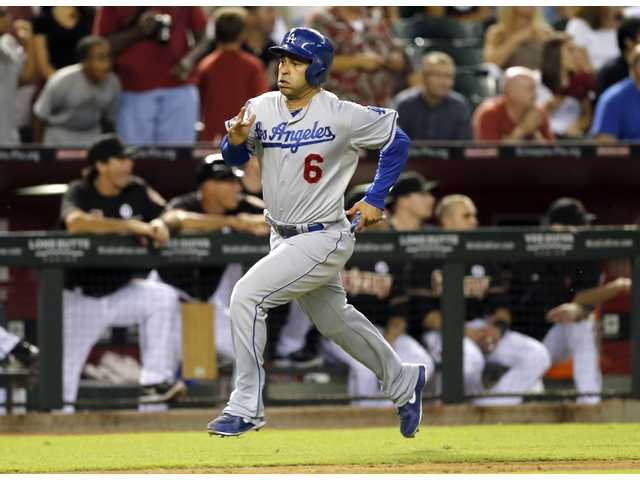 Los Angeles Dodger Jerry Hairston scores the tying run against the Arizona Diamondbacks on Wednesday in Phoenix.