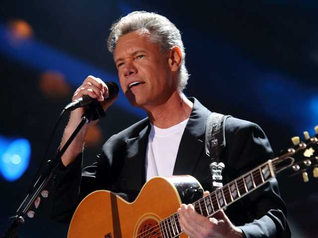 Randy Travis. performing at the 2013 CMA Music Festival, underwent brain surgery on Thursday following a stroke.