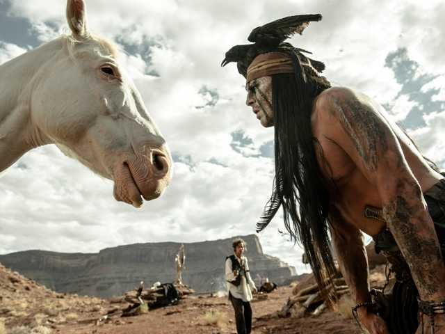 "Johnny Depp, right, as Tonto, in a scene from ""The Lone Ranger."" Depp may be willing to plunk down millions to buy the Wounded Knee National Landmark. Associated Press/Disney"
