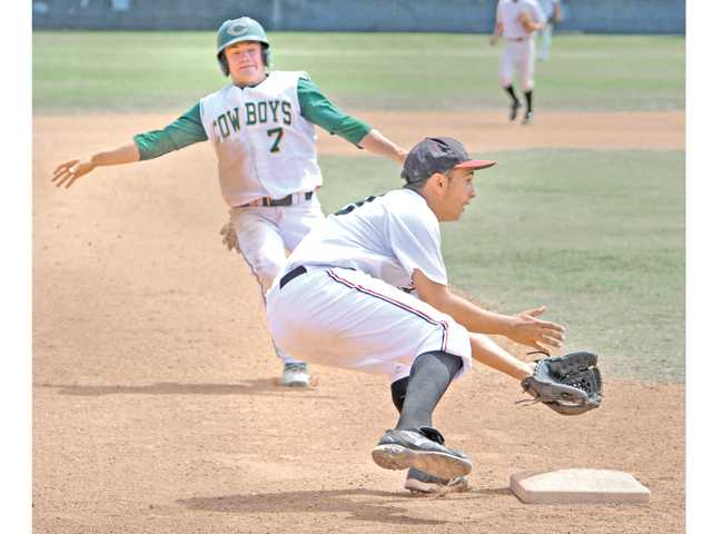 Canyon's Cole Mears, left, beats the throw to Hart's Leif Vera during a Valley Invitational Baseball League game at Hart High on Friday.