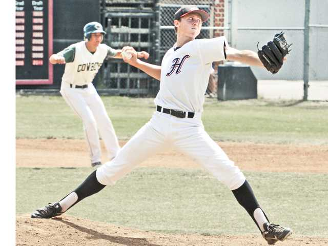 Canyon's Nick Tarolli, left, leads off at first base as Hart pitcher Miles tsujimota winds up. Canyon, Hart, Saugus, Valencia and West Ranch are taking part in VIBL play.