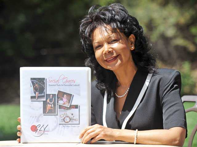 """Grace Lee with her book """"Social Graces: Essential Tools for Successful Ladies."""" Photo by Jonathan Pobre/The Signal."""