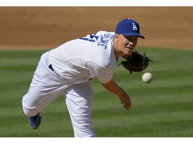 Los Angeles Dodgers starting pitcher Zack Greinke throws to the plate during the second inning against the Colorado Rockies on Saturday  in Los Angeles.