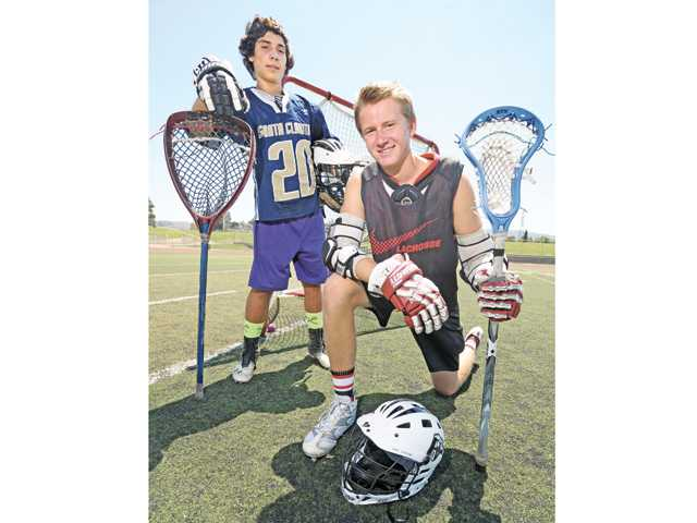 Lacrosse players Jacob McDonagh, left, of Valencia High, and Taylor Todd, of Hart High, played together last season on the club leve. This spring, they could face off as rivals as each school hopes to have a CIF-sanctioned lacrosse team this spring. Photo by Dan Watson.