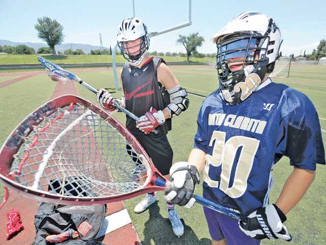 Lacrosse players Taylor Todd, left, and Jacob McDonagh. Photo by Dan Watson.