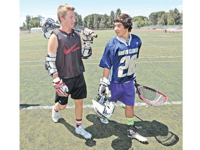 Lacrosse players Taylor Todd, left, of Hart High and Jacob McDonagh, of Valencia High. Photo by Dan Watson.