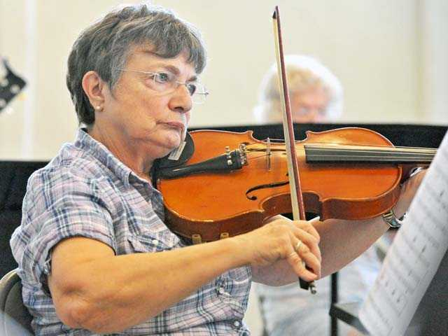 Terry Montross rehearses with her viola with the Santa Clarita Valley Senior Orchestra during rehearsal Monday. Signal photo by Jonathan Pobre