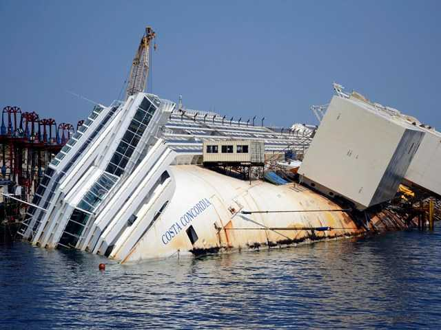 The Costa Concordia in the Tuscan Island of Isola del Giglio, Monday. Salvage crews are working against time to right and remove the shipwreck which is being crushed under its own weight.