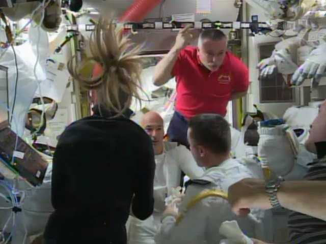Astronauts discuss the aborted spacewalk aboard the International Space Station on Tuesday. A dangerous water leak in the helmet of Luca Parmitano drenched his eyes, nose and mouth. preventing him from hearing or speaking