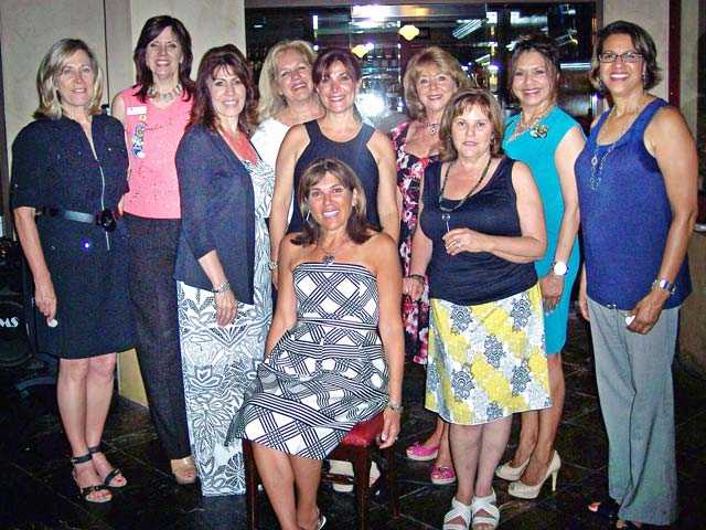Vanessa Wilk, seated, was recently installed as President of Soroptimist International of Santa Clarita Valley. Her board of directors for 2013-14 are pictured standing around her at the installation dinner event held in Canyon Country.