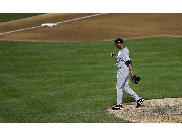 American League's Mariano Rivera, of the New York Yankees, reacts during the MLB All-Star  game on Tuesday in New York.