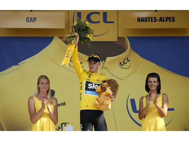 Christopher Froome celebrates on the podium of the 16th stage of the Tour de France in Gap, France on Tuesday.