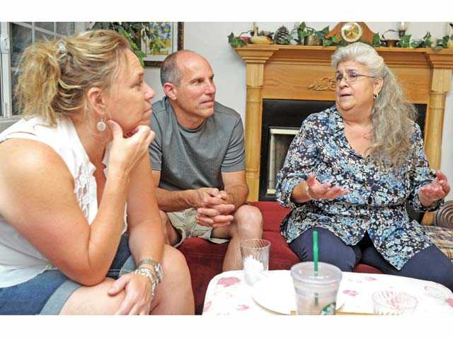 Berta Gonzalez-Harper, right, discusses her Santa Clarita City Council campaign with Michele Collins, left, and husband Rick Collins at Gonzalez-Harper's home in Canyon Country on Thursday.