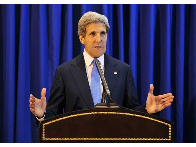 U.S. Secretary of State John Kerry speaks during a press conference at Queen Alia International Airport on Friday.