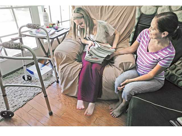 Emalee Banry, left, and her mother Allison go through wedding magazines at Allison's Castaic home.