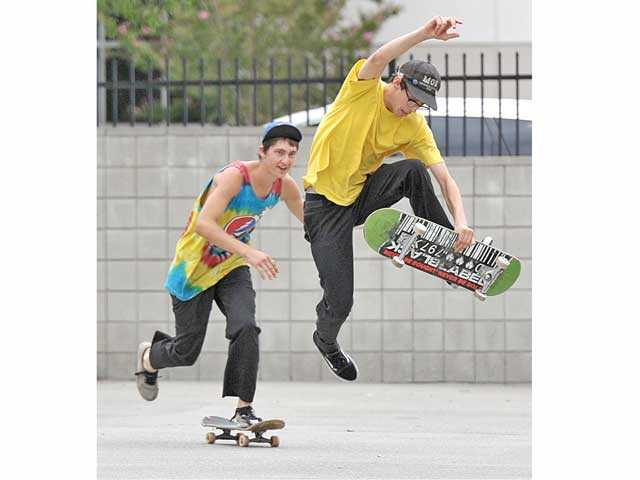 "Local teenagers Kevin Conway, left, and Garrison Saenz show off some skating skills. Both were featured in the documentary film ""Only the Young."""