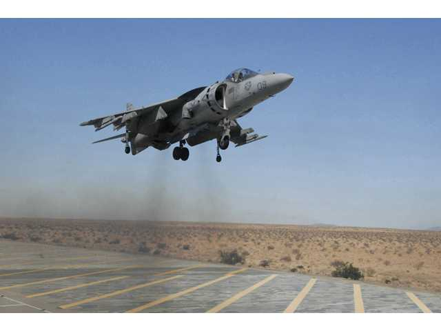 In this Sept. 12, 2008 file photo provided by the U.S. Marine Corps., Capt. Andrew D'Ambrogi, Marine Attack Squadron 211 pilot, prepares to land an AV-8B Harrier at Auxiliary Airfield II, a simulated amphibious assault ship flight deck on the Barry M. Goldwater Range in Yuma, Ariz.