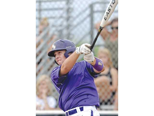 Valencia catcher Anthony Lepre hits a two-run home run against West Clovis in The California Classic baseball tournament on Sunday at Valencia High School. Photo byJayne Kamin-Oncea/For The Signal