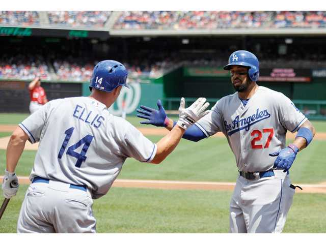 Los Angeles Dodgers outfielder Matt Kemp (27) celebrates his home run with teammate Mark Ellis (14) on Sunday against in Washington.