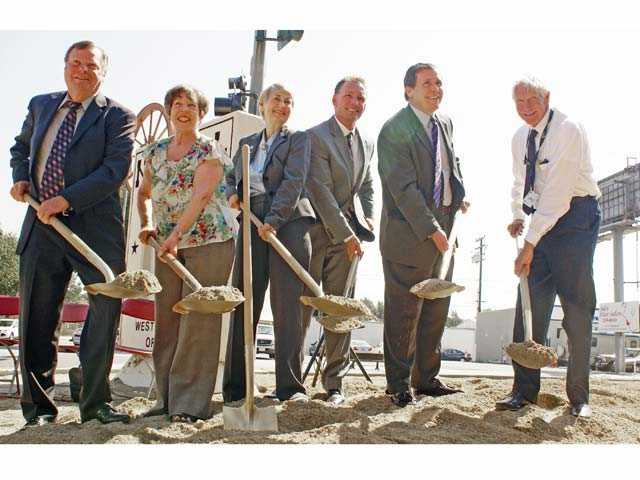 From left, Santa Clarita City Council members Bob Kellar, Marsha McLean and Laurene Weste, City Manager Ken Striplin, Assemblyman Scott Wilk, R-Santa Clarita, and Los Angeles County official Hayden Sohm break ground for the Newhall roundabout. Signal photo by Jim Holt
