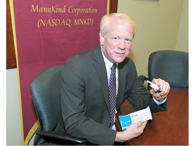 Matthew Pfeffer of MannKind Corporation displays the Afrezza inhaler in the company's Valencia office.