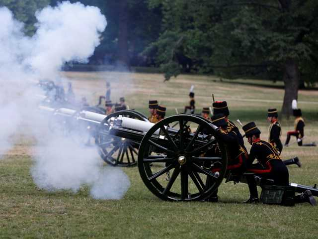 The King's Troop Royal Horse Artillery fire a 41 Royal Gun Salute in Green Park, to mark the birth of a baby boy of Prince William and Kate, Duchess of Cambridge Tuesday.