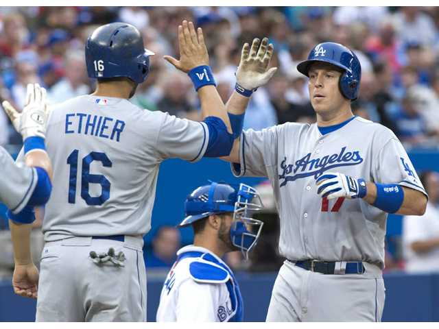 Los Angeles Dodgers catcher A.J. Ellis, right, celebrates his two-run home run with teammate Andre Ethier against the Toronto Blue Jays in Toronto on Monday.