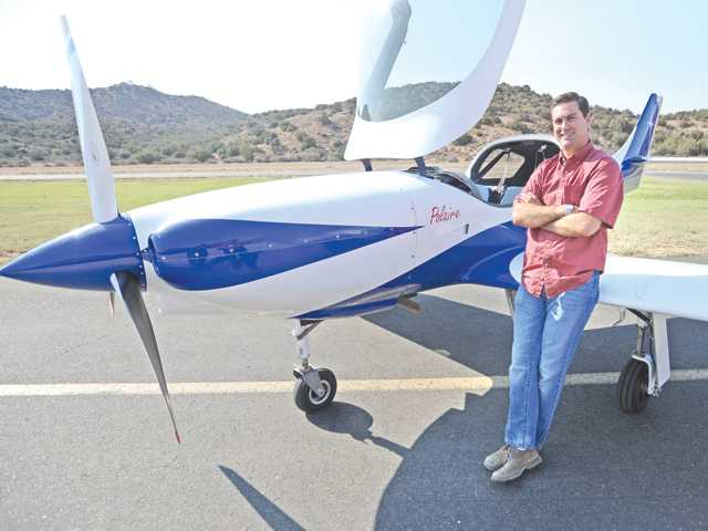 Brandon Cangiano with his home-built Lancair Legacy airplane at Agua Dulce Airport. Signal photo by Dan Watson