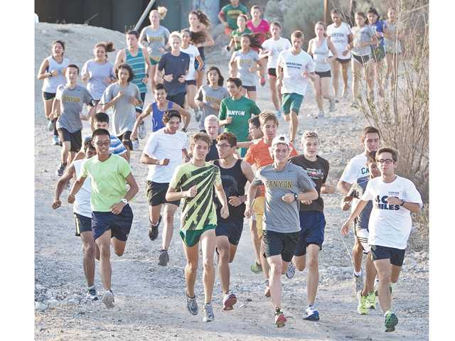 Canyon High runners start off on their twice weekly evening run from Lost Canyon Road in Canyon Country on Wednesday.