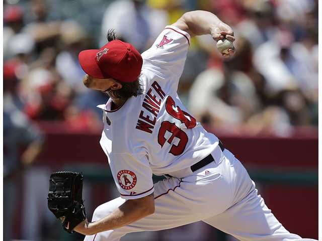 Los Angeles Angels starting pitcher Jered Weaver throws during against the Minnesota Twins on Wednesday in Anaheim.