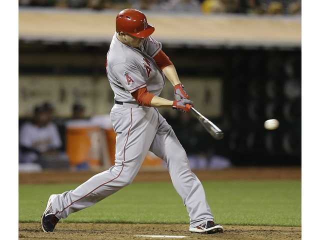 Los Angeles Angels' Mark Trumbo connects for a two run double off Oakland Athletics' Dan Straily in the fifth inning  Thursday in Oakland.