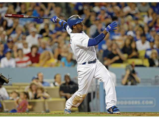 Los Angeles Dodgers' Hanley Ramirez connects on a two-run homer against the Cincinnati Reds in the fifth inning in Los Angeles on Friday.