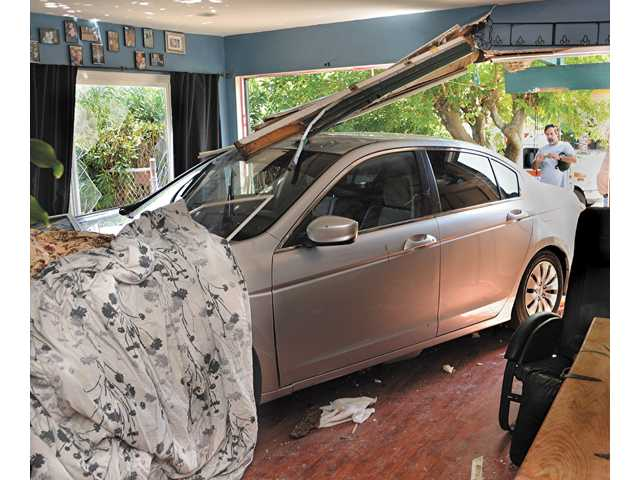 Four people were injured Saturday afternoon after the driver of the Honda Accord lost control and careened through the living room of a home at Wistaria Valley Road in Canyon Country.