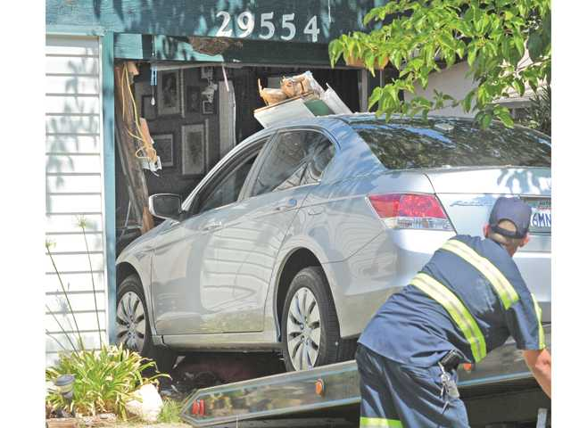 A Late Model Honda Accord Is Pulled From The Front Room Of Home At Wistaria