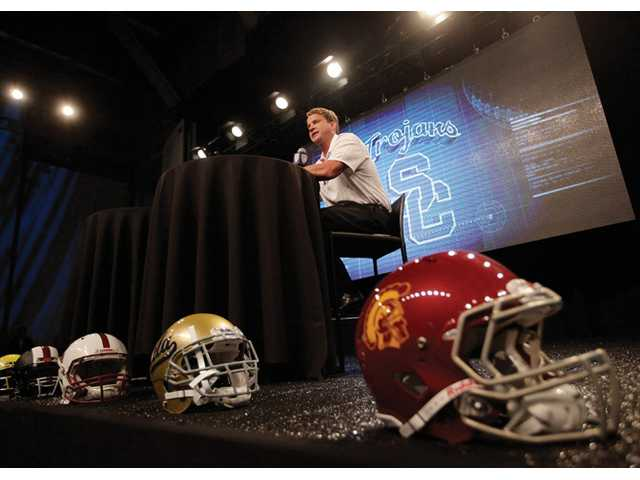 Southern California head coach Lane Kiffin talks to the media during Pac-12 media day on Friday in Culver City.