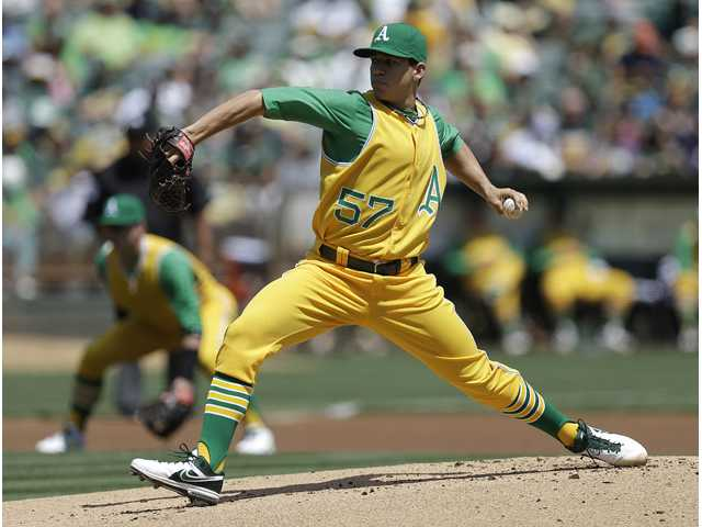 Oakland Athletic Tommy Milone works against the Los Angeles Angels on Saturday in Oakland.