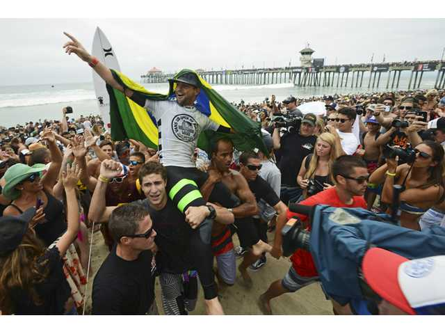 Alejo Muniz was crowned the men's champion of the 2013 Vans US Open of Surfing competition on Sunday in Huntington Beach.