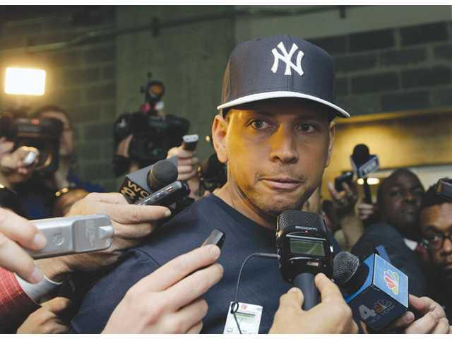 New York Yankees player Alex Rodriguez talks to reporters on April 1 in New York.