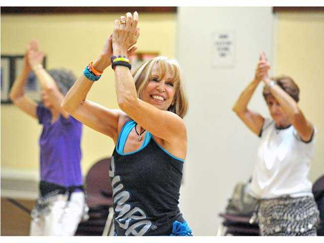 Diane Hedrick leads a Zumba Gold fitness class at the Santa Clarita Valley Senior Center in Newhall. Photo by Jonathan Pobre.