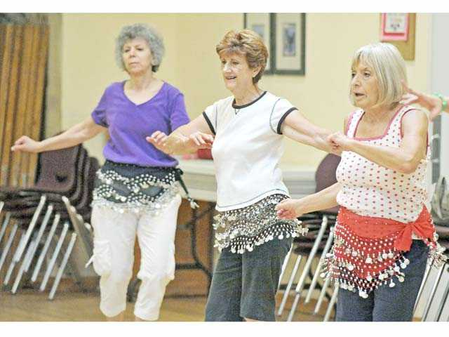 From left, Esther Sternin, Ada Paul, and Doris Sipotz take part in a Zumba Gold fitness class at the Santa Clarita Valley Senior Center in Newhall on Monday. Photo by Jonathan Pobre.
