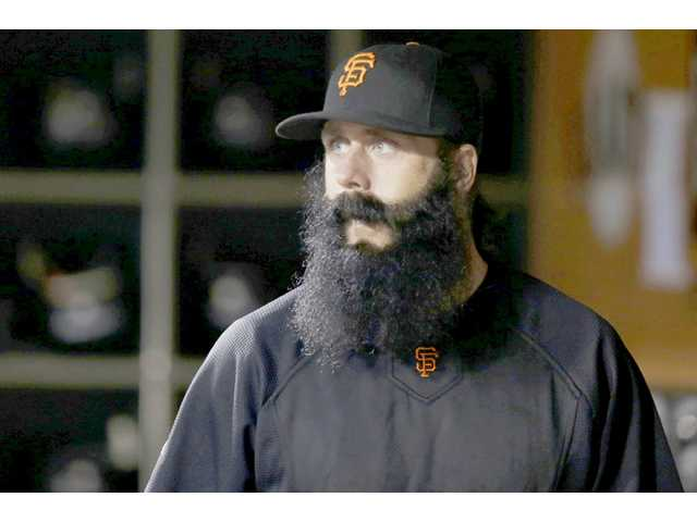 Former San Francisco Giants pitcher Brian Wilson signed with the Los Angeles Dodgers on Tuesday.