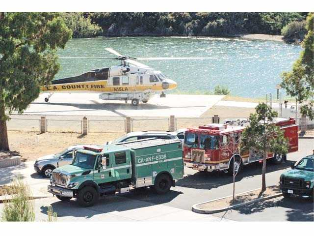 A Los Angeles County Fire Department helicopter lifts off at Pyramid Lake with a critically injured man after a collision at Pyramid Lake in July 2012. One teen was killed in the collision between a Waverunner and a ski boat. Signal file photo by Rick McClure