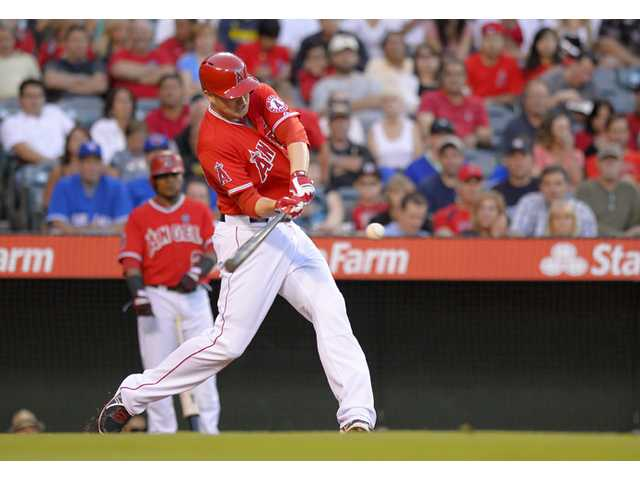Los Angeles Angels' Mark Trumbo hits a two-run home run during the first inning against the Toronto Blue Jays on Thursday in Anaheim.