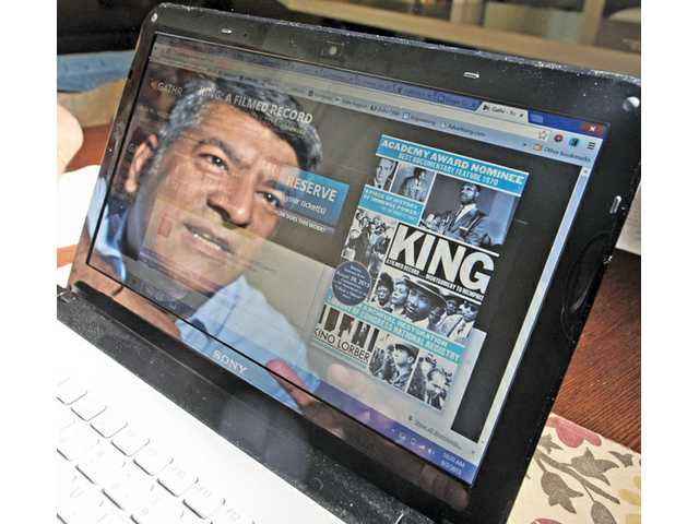 "Reza Rassool's reflection is seen in his laptop, showing the web page for the film ""King: A Filmed Record."" The Stevenson Ranch resident is part of a new crowd-sourcing platform that allows people to bring films to their local theaters."