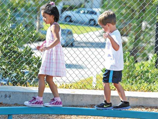 Castaic Elementary School children play during recess on their first day at Castaic Elementary School on Monday.